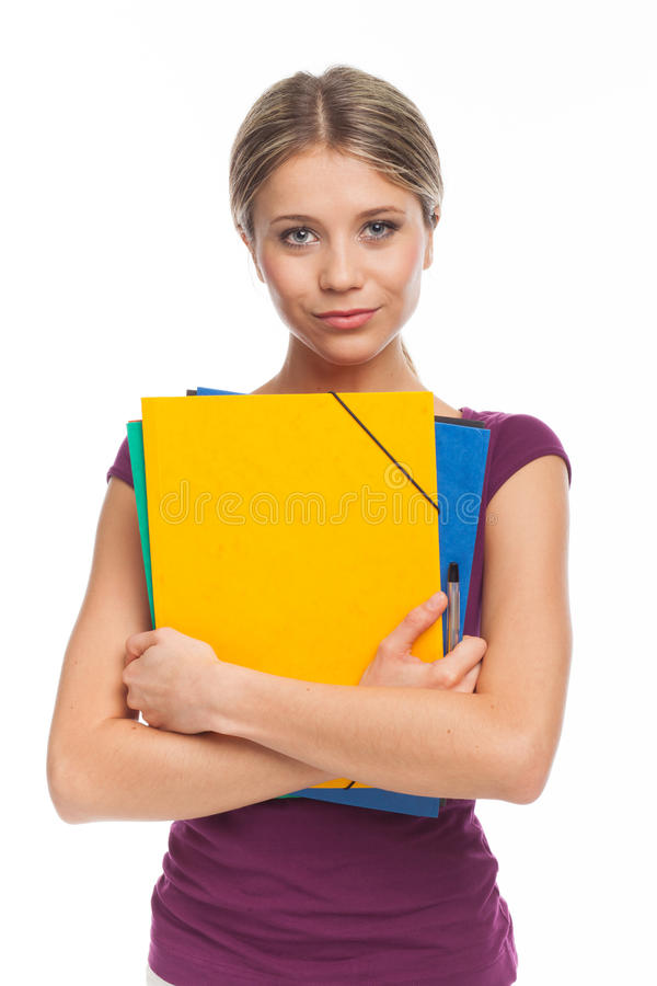 Cute girl holding folders. Beautiful young woman holding folders, on white royalty free stock photo