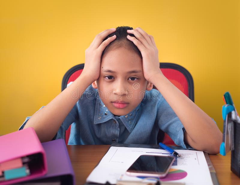 Cute girl holding her head upset by hard work royalty free stock photos