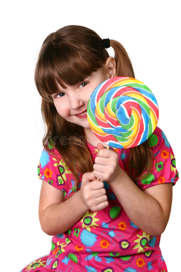 Download Cute Girl Holding Large Lollipop Stock Photo - Image: 4163210