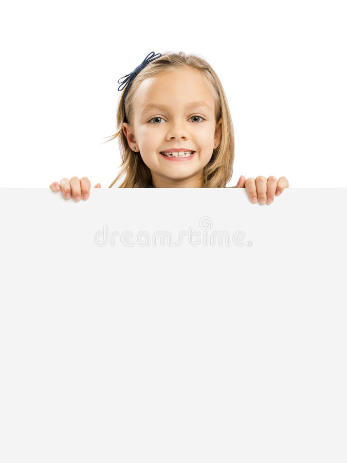 Cute Girl holding a whiteboard. Beautiful little girl holding and showing something on a whiteboard stock images