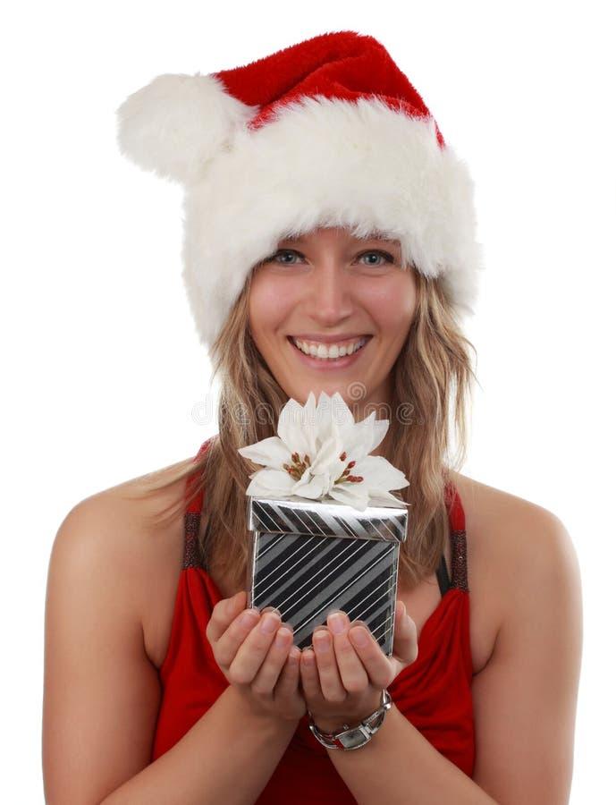 Cute girl holding xmas gift royalty free stock photo