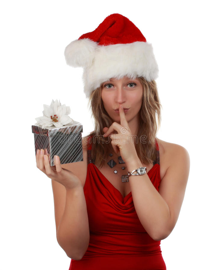 Cute girl holding xmas gift royalty free stock photography