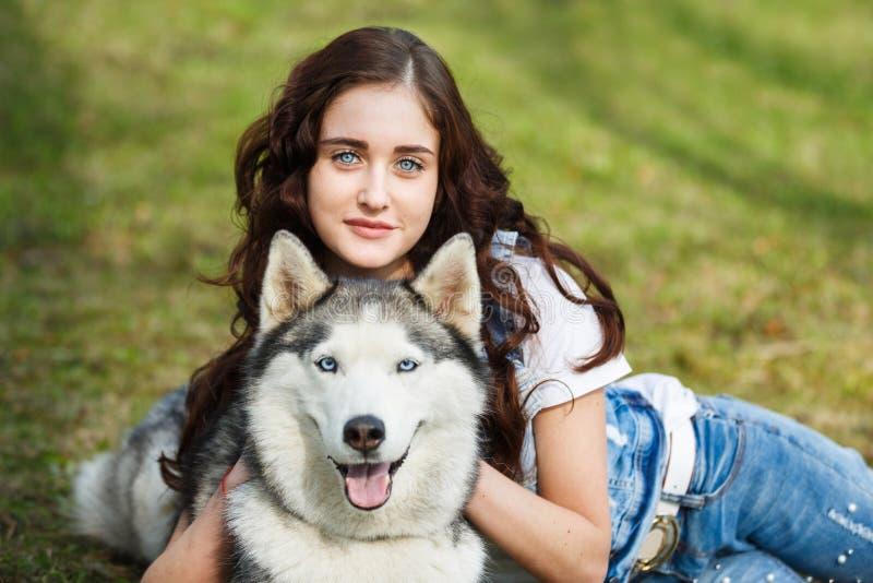 Cute girl with husky dog stock photo