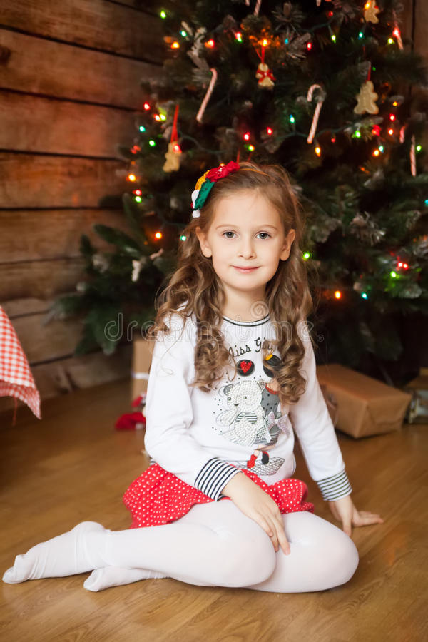 Free Cute Girl In Front Of Decorated Tree Stock Image - 77388021