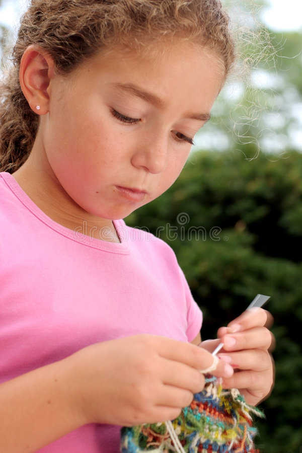Cute girl knitting royalty free stock images