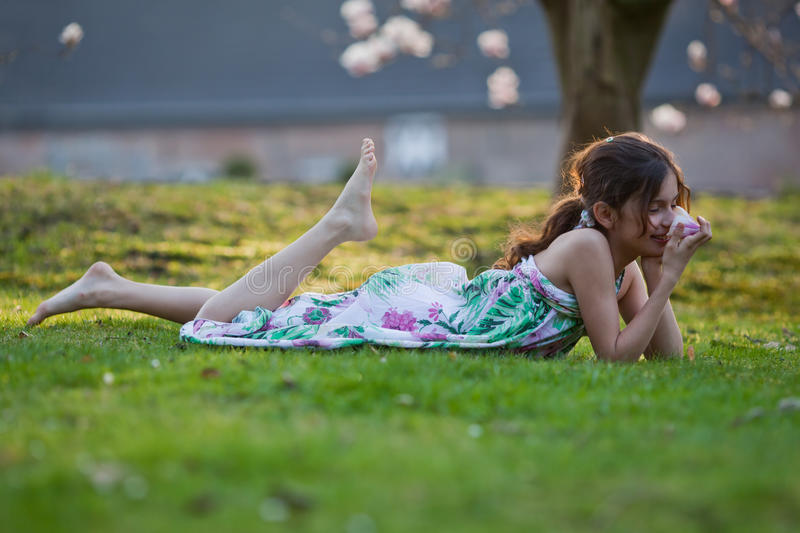 Download Cute Girl Lies Dreamy In The Grass Stock Image - Image: 24448915