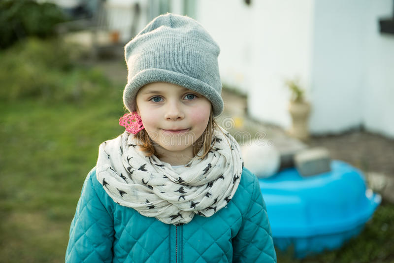Cute Girl. A cute little girl dressed for the cold royalty free stock photos