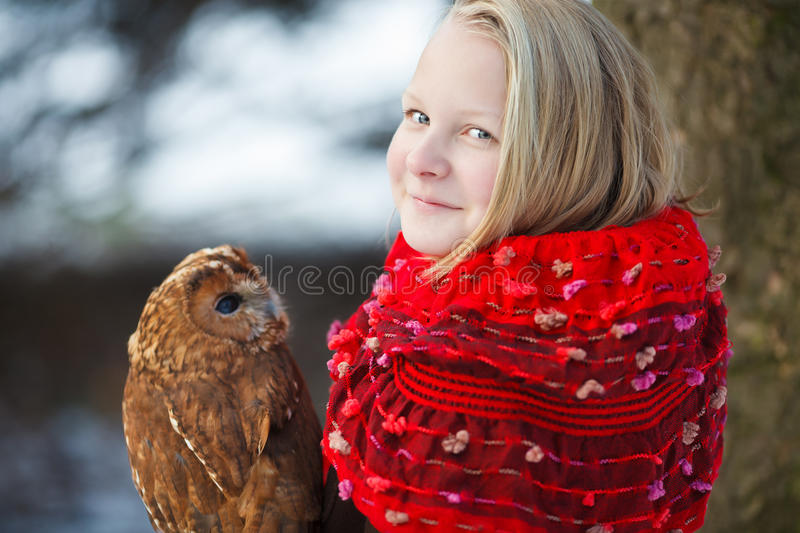 Cute girl with little owl stock image