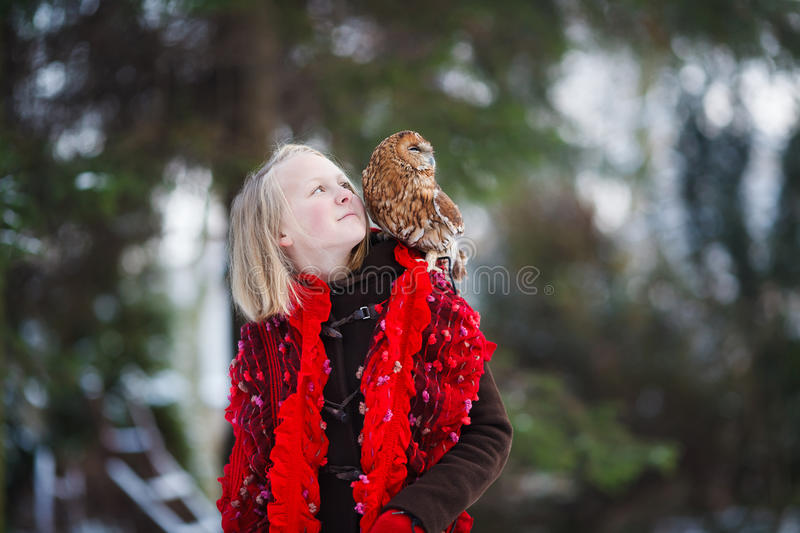 Cute girl with little owl stock images