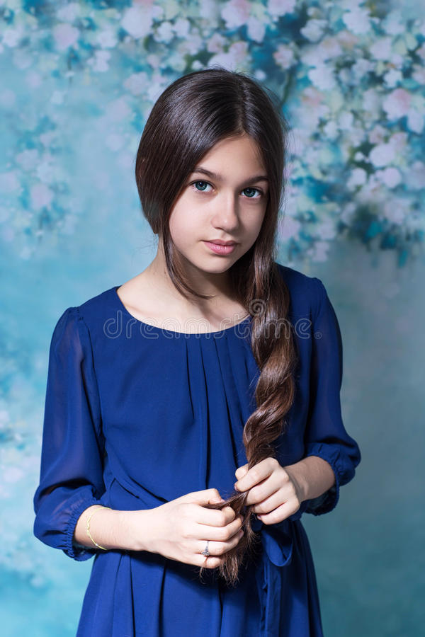 Cute girl with long hair looking at the camera royalty free stock image