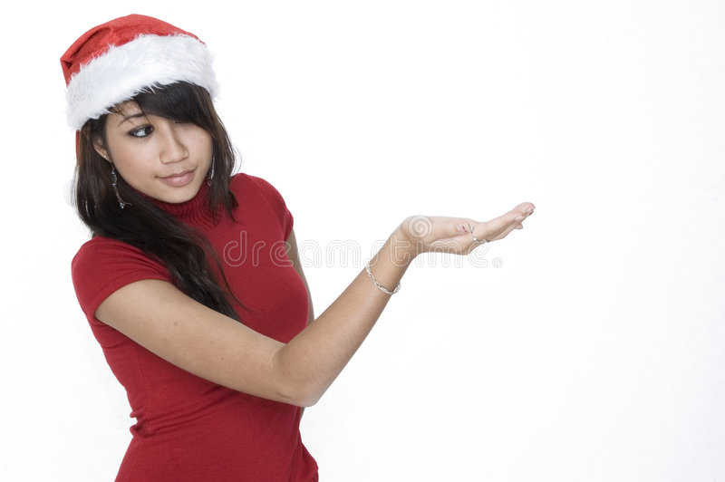 Cute Girl Looking At Your Product Royalty Free Stock Photo