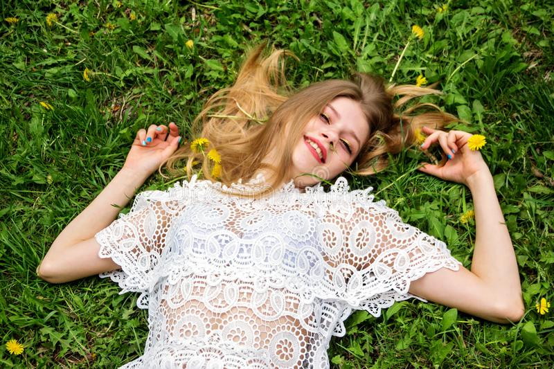 Cute girl lying on the grass. royalty free stock photo