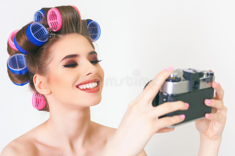 Cute girl make a foto selfie at vintage camera. Image of cute girl make a photo selfie at vintage camera. Take a photograph of herself. Funny, party. Beauty royalty free stock image