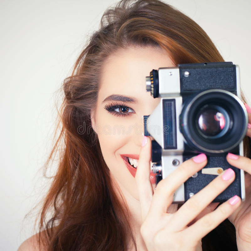 Cute girl make a foto selfie at vintage camera. Image of cute girl make a foto selfie at vintage camera. Take a photograph of himself. Funny, party. Beauty royalty free stock photos