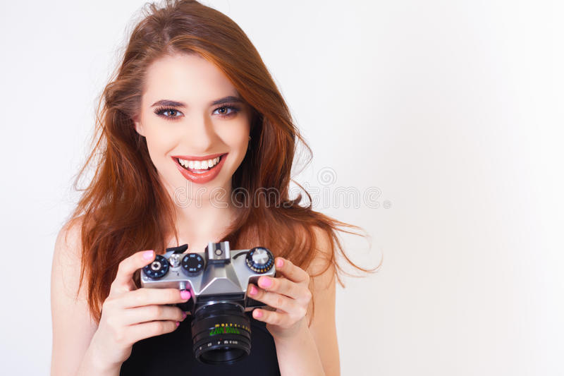 Cute girl make a foto selfie at vintage camera. Image of cute girl make a foto selfie at vintage camera. Take a photograph of himself. Funny, party. Beauty royalty free stock photo