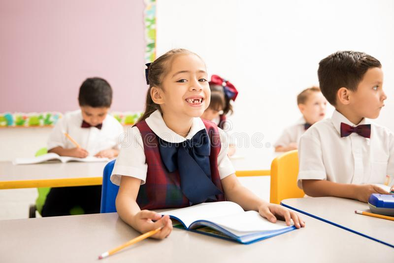 Cute girl with missing teeth in school royalty free stock photo