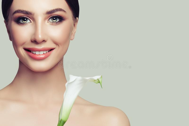 Cute girl with natural make up posing at grey studio background stock photo