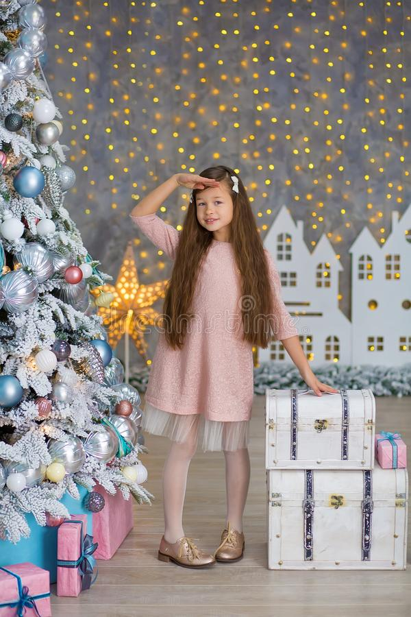 Cute girl near the Christmas tree enjoy miracle winter time. Christmas concept. Belief in miracles royalty free stock photos
