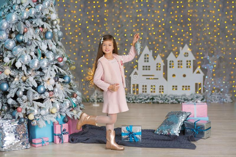 Cute girl near the Christmas tree enjoy miracle winter time. Christmas concept. Belief in miracles.  royalty free stock photos