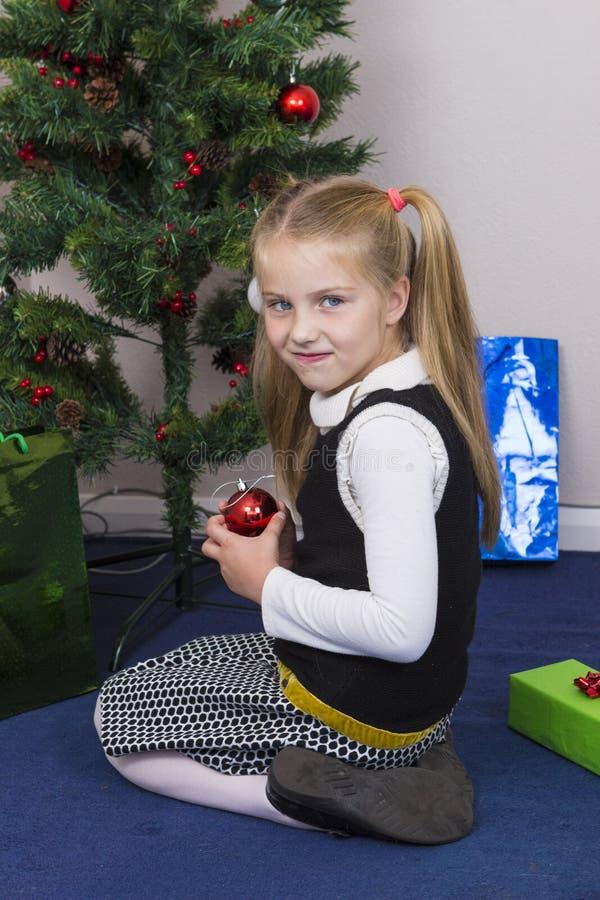 Cute girl near New Year tree stock photo