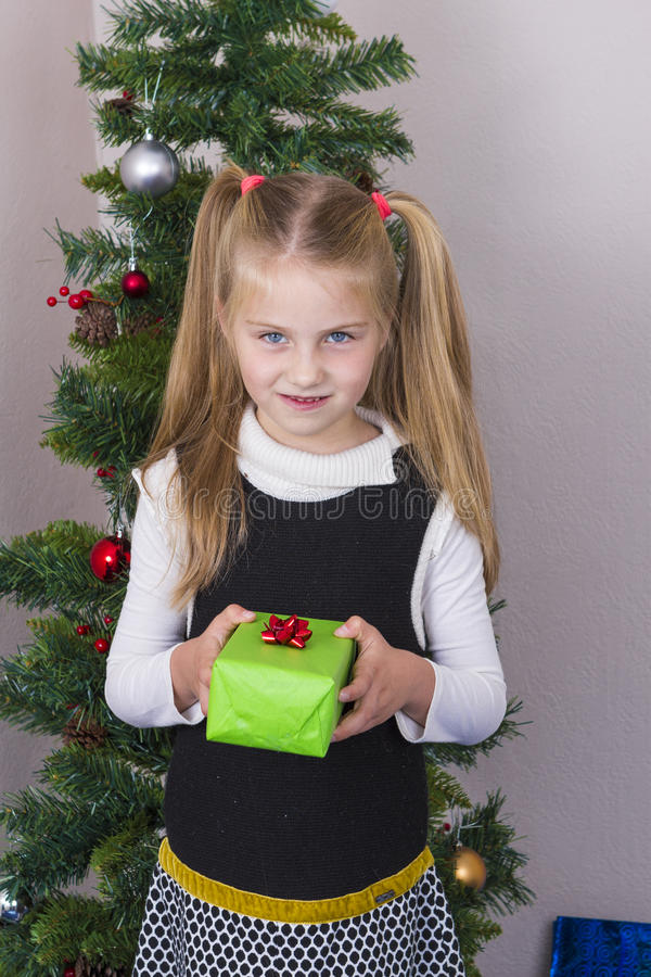 Cute girl near New Year tree royalty free stock images