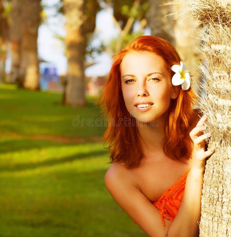 Cute girl near palm tree