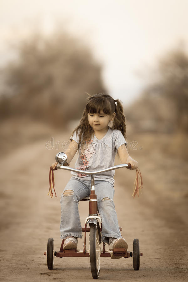 Free Cute Girl On Tricycle All About The Accessories Stock Image - 38612381
