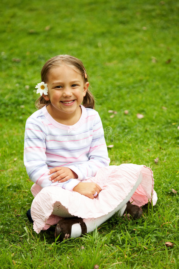 Download Cute girl outdoors stock photo. Image of flowers, cute - 4409368