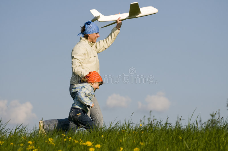 Download Cute girl with plane stock photo. Image of aeroplane, aspiration - 5099740
