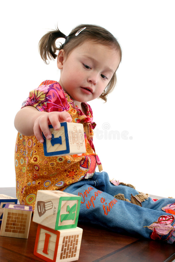 Cute girl playing stock photo