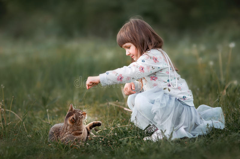 Cute girl playing with stock photography