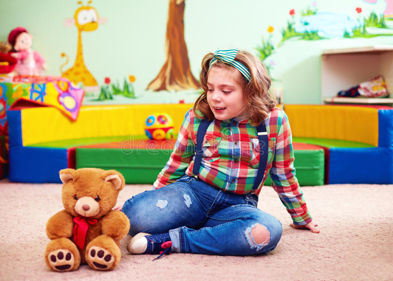 Cute girl playing in kindergarten for kids with special needs royalty free stock photography