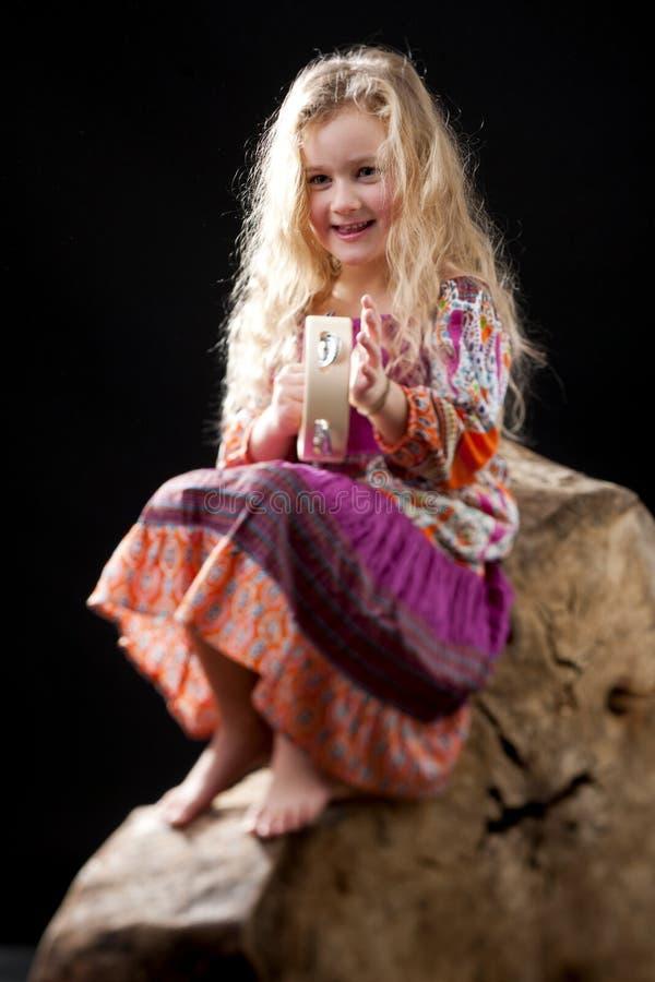 Download Cute Girl Playing Tamburine Stock Photo - Image: 26235428
