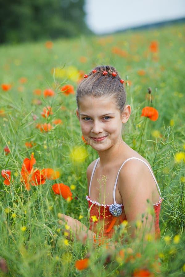 Cute girl in poppy field royalty free stock photos