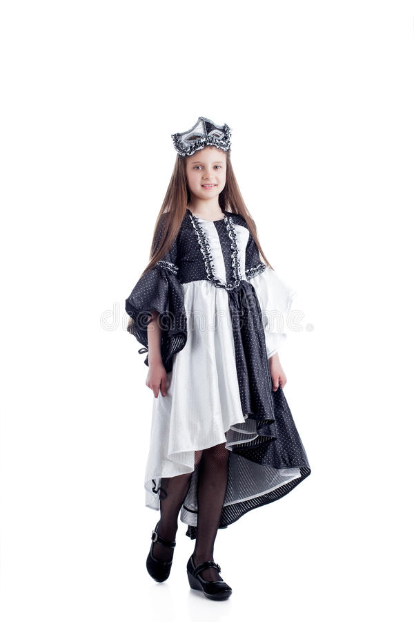 Cute girl posing in harlequin dress with mask stock photos