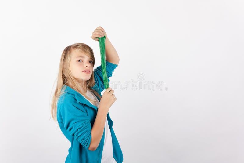 Cute girl posing with her handmade slime stock photo