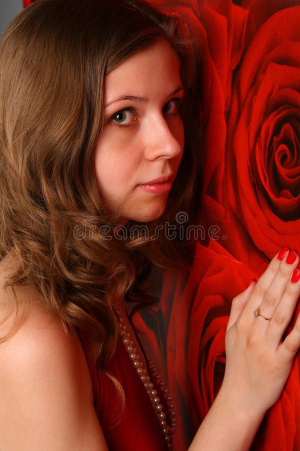 Download Cute Girl Posing At Red Wall. Stock Photo - Image: 19440158