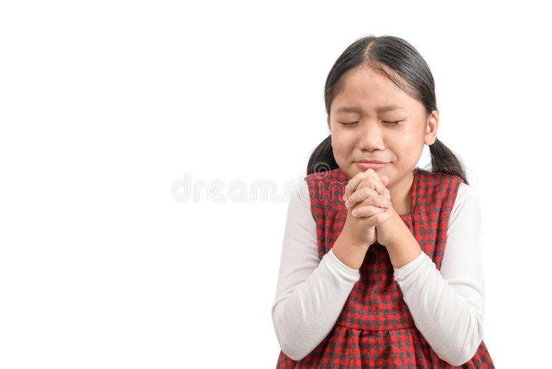 Cute girl praying and cry isolated on white background stock photos