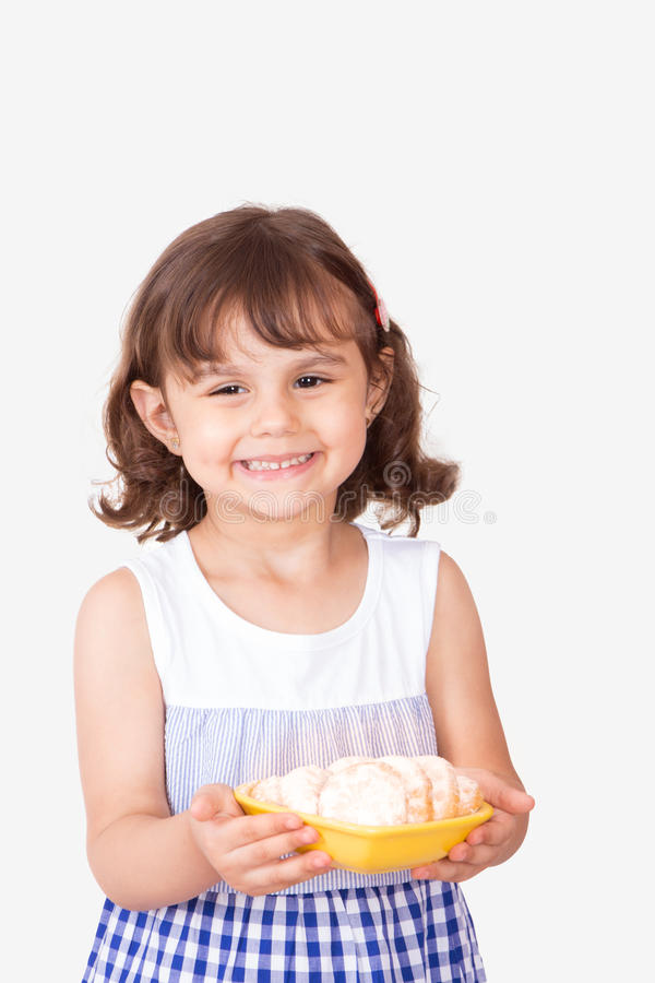 Cute girl presenting kahk el Eid for guests royalty free stock image