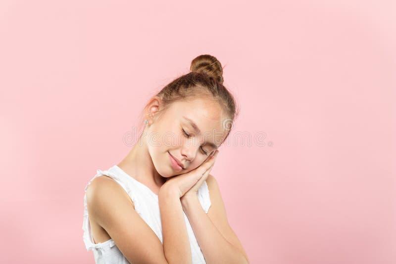 Cute girl pretend sleep hands pillow dreamy child stock photos