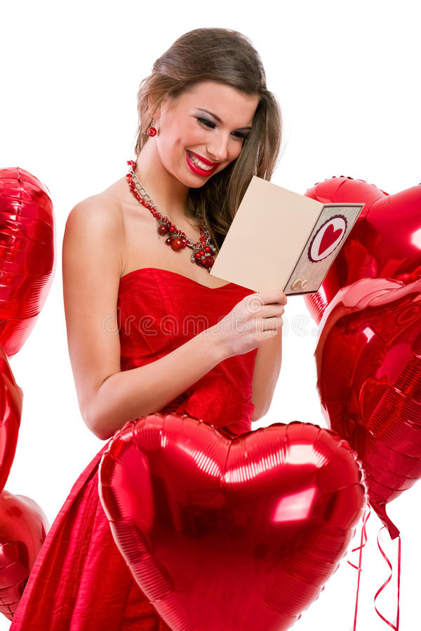 Cute girl reading Valentine card stock photography