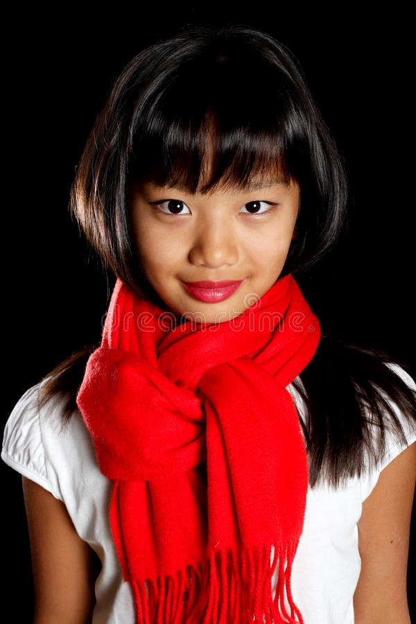 Cute girl in a red scarf stock image