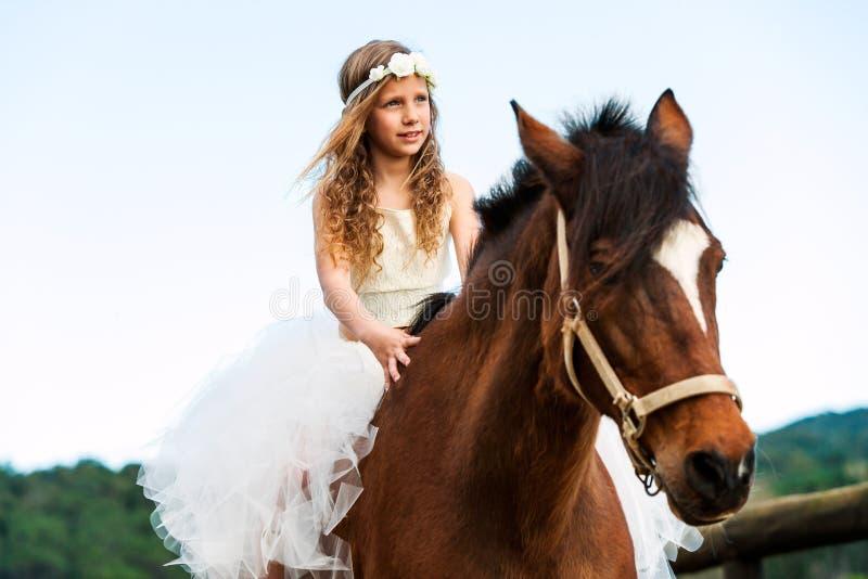 Cute girl riding horse. stock image