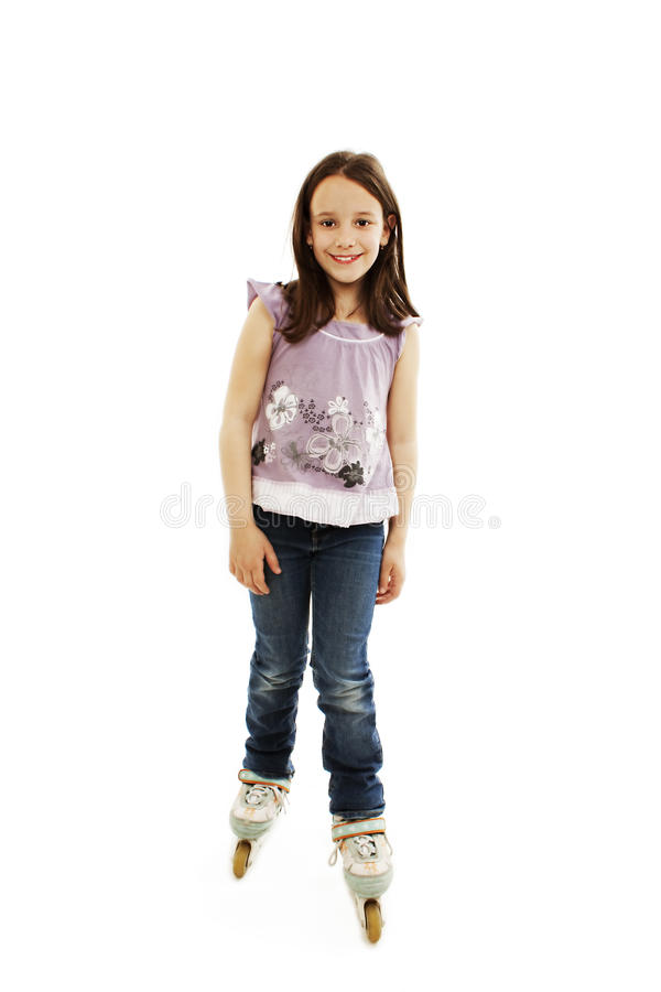 Download Cute girl in roller skates stock photo. Image of jeans - 25258200