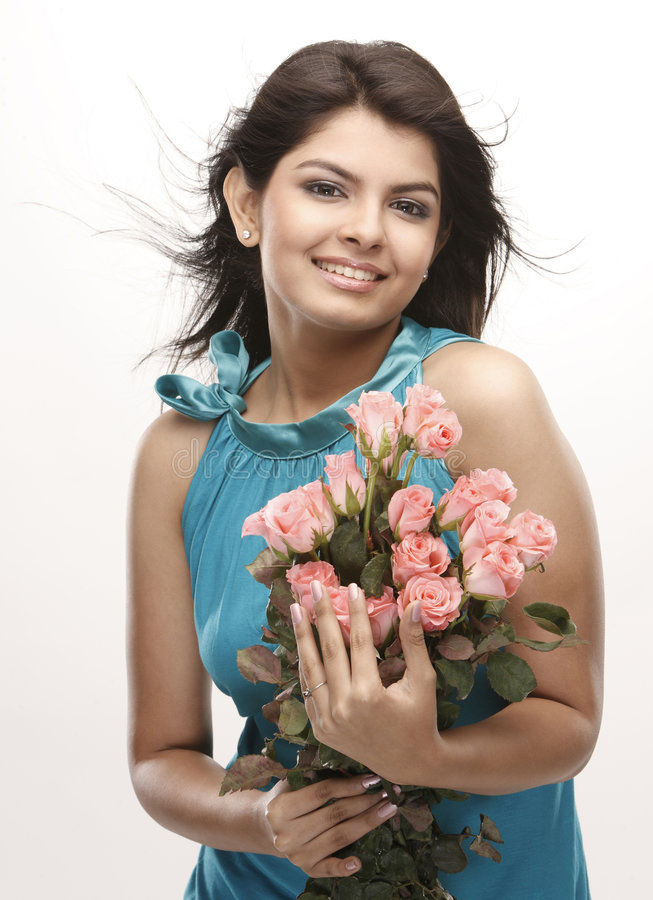 Cute girl with roses royalty free stock photo