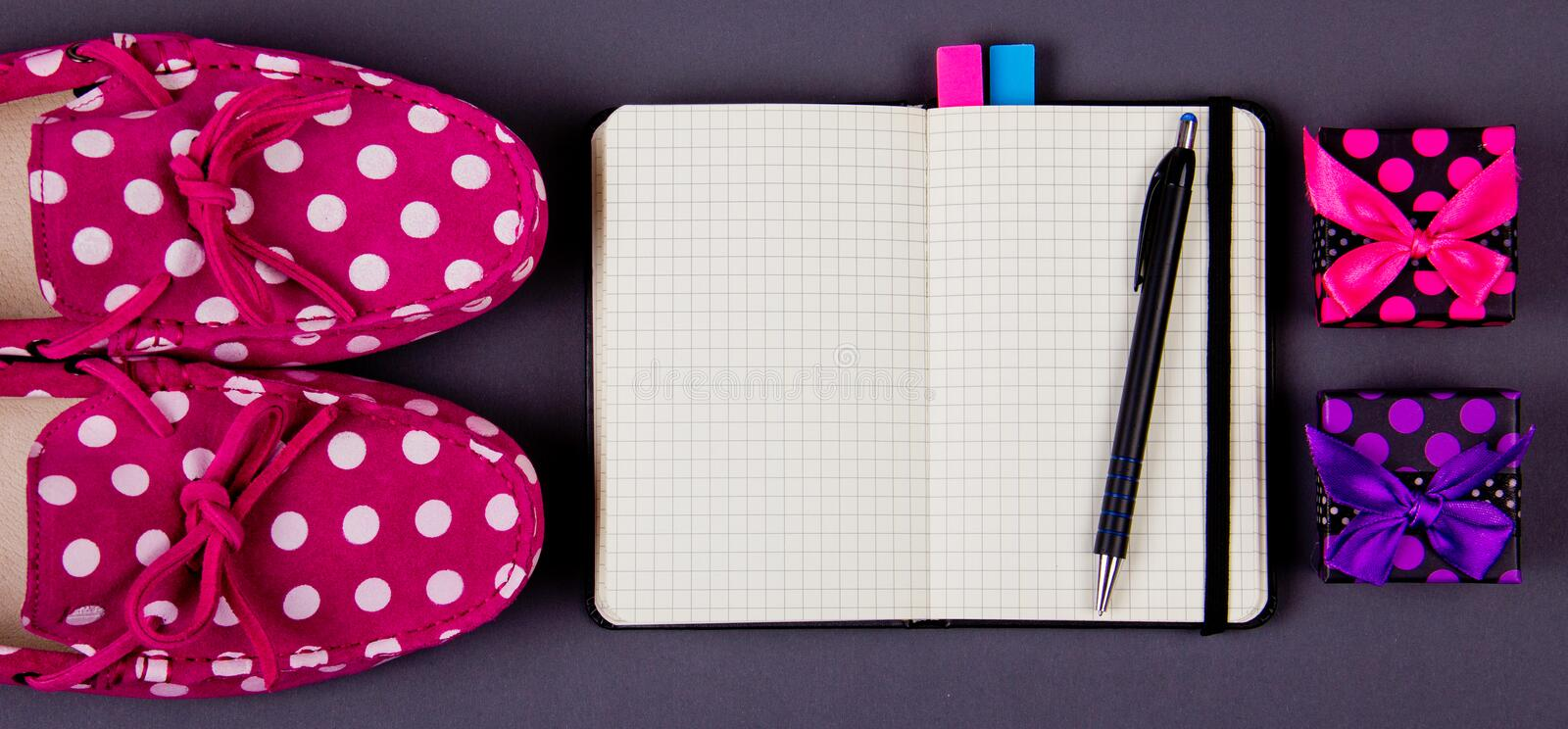 Cute girl's shoes, notebook and gift boxes. place for your text royalty free stock photo