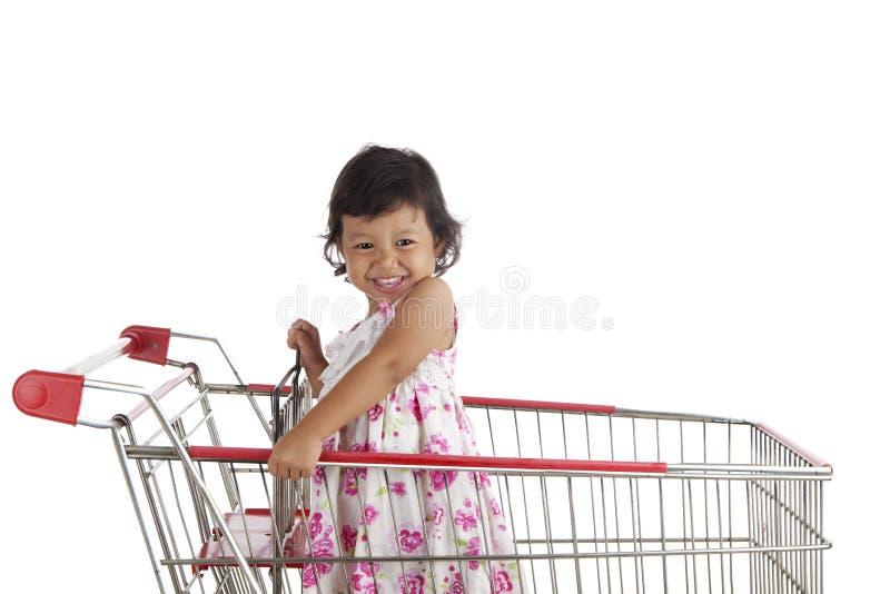 Cute Girl On Shopping Cart Stock Photos