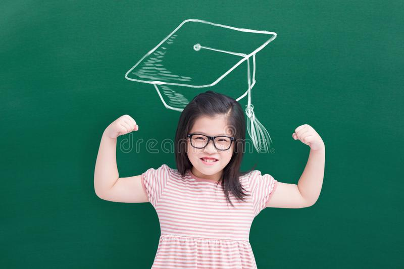 Cute girl show strong arm royalty free stock image