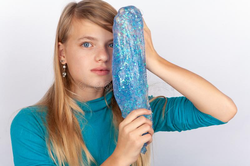 Cute girl showing a slime royalty free stock photo