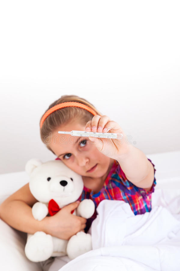 Cute girl showing thermometer royalty free stock photography